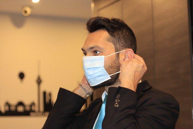 man putting on mask